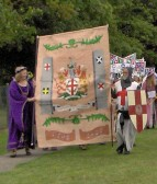 Part of the parade of the Huntingdon 800 celebrations. Derek Adams and wife lead the Society of St George with their banner.