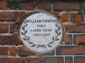 Wall plaque on Cowper House Huntingdon. ( note plaque 20th century.)