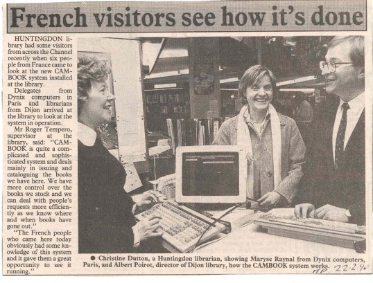 French visitors sample the Cambook system at the library.( source - The Hunts Post.)