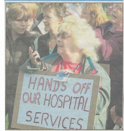 Protester at Hospital rally. ( source - Hunts Post.)