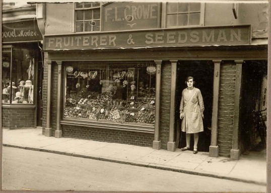Lucy Crowe of F L Crowe, fruiterer, & seedsman, 134, High St. Lucy & her cousin Fred were partners. Photo D A Hufford. Adjacent shop  Miss Horwood.