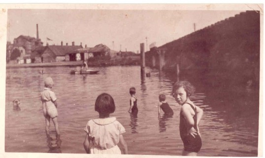 Edna Canwell and friends bathing by the railway bridge at Castle Hills and view to bridge boat yard Godmanchester.Source Beryl Domaine.