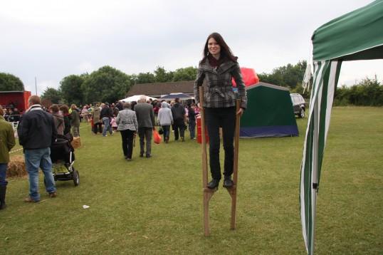 Emily Gilbert carrying on the Family Tradition of Stilt Walking at the Little Downham Village Fete.