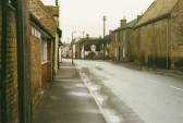 Main Street, Little Downham.  Taken outside of W B Chambers & Son who were a major employer in the village.