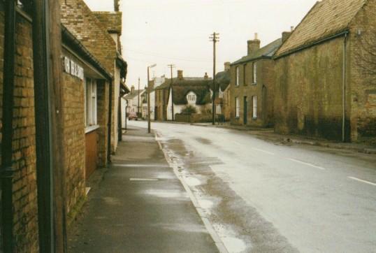 Main Street, Little Downham.  Taken outside of W B Chambers & Son who were a major employer in the village.