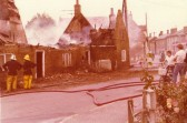 Fire Brigade attending burning cottages in Main Street.