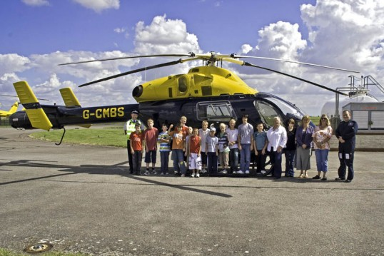 Little Downham Youth Club with police helicopter at RAF Wyton.