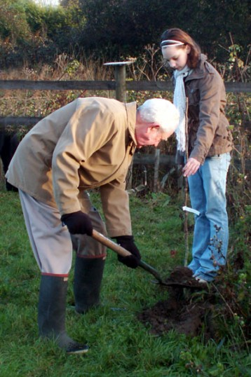Derick Last and Jamie Murfett planting a tree in memory of Mary Maculiffe.. Memorial tree