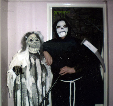 Halloween. Two of the village's odder residents emerge for the Book Cafe party.