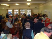 Village Hall, Organs and Bygones (7). Crowd in the Village Hall around a display of small..