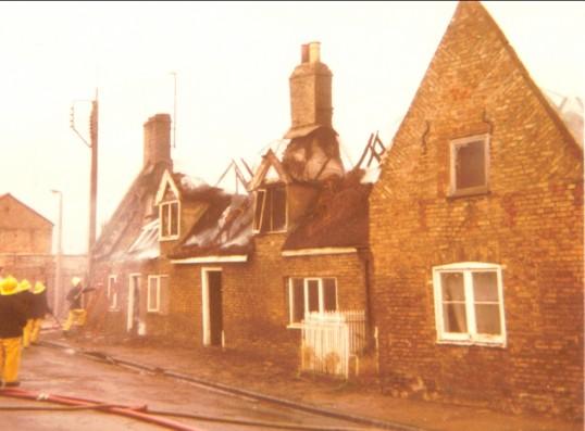 16th Century building on fire, Main Street, Little Downham.