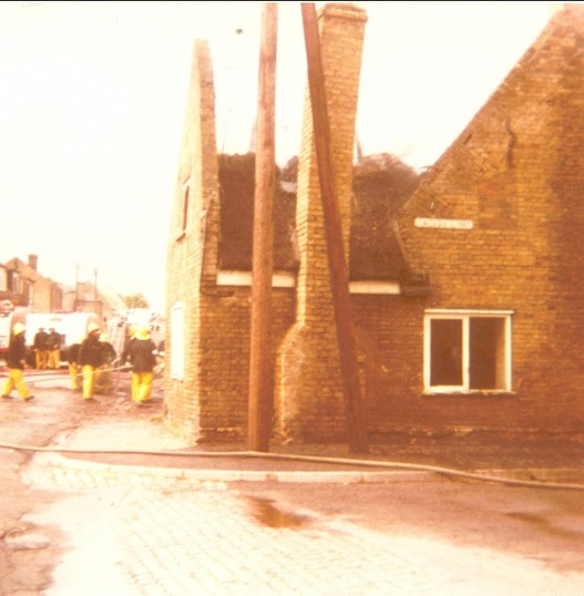 Side view of 16th Century House  After the fire. Main Street, Little Downham.