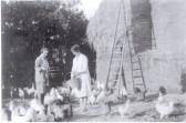 Bertha Hatley (nee Darling) feeding hens.  Rosemont, Church Walk - Lode