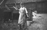 Farm boy, Bob Leader, with pail