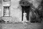 Mrs Sheldrick outside Flambards Mill cottage, Flambards Close, Meldreth, prior to its demolition