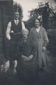Mary Ann Moxon with George (son) and Beck (daughter) outside her cottage in Stone Lane, North End, Meldreth.