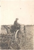 Frank Course on a tractor, towing a cultivator, at Northfield Farm, Malton Lane, Meldreth