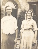 Frank Course pictured with his mother outside the front door of Northfield House, Malton Lane, Meldreth.