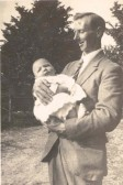 Frank Course, holding his son Raymond at Northfield House, Malton Lane, Meldreth.