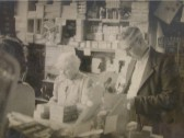 Charles (Jim) Rayner with Mrs Handscombe in the Village Shop, High Street, Meldreth