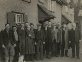 Group of Locals standing outside the British Queen public House, High Street, Meldreth, Christmas 1942.