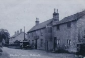 The Railway Tavern public house and Allerton Terrace Railway cottages in the background, High Street, Meldreth