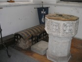 The Parish Chest and Font in the Holy Trinity Church, North End, Meldreth.