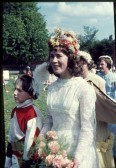 The May Queen, Gillian Fleet, arrives at the Primary School, following the procession along the High Street, Meldreth.