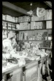 Meldreth Post Office and Stores, High Street.  John Smith serving in the shop.