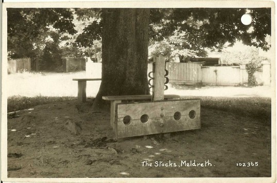 Meldreth village stocks and whipping post at the junction of High Street, Fenny Lane and North End.