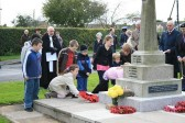 Children lay wreaths for the fallen at Mepal War Memorial