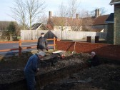 A working party prepare the ground for Mepal Village Hall improvements.