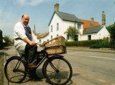 Michael Braysher on his newly restored butcher's delivery bike, High Street ,Orwell. The Butcher's delivery bicycle