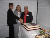 Pauline Northrop, Susan Knebel and Shirley Lambert. Cutting the cake at the Orwell Methodist Church Centenary Celebrations.