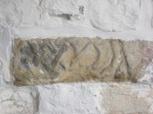 Part of a coffin lid let into the wall of the South Porch at St. Andrew's Church Orwell.