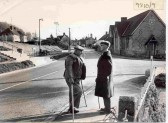 Orwell High Street showing former Village School with Fred Pett (left) and friend in foreground.