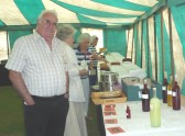 Orwell Show 2010. Mike Kenyon, chief steward of the   Show, with beer & wine entries.