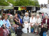 Shoppers from Orwell at St Neots Market waiting for the bus back.