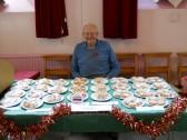 Cyril Heaps sits at his cake stall at the Pymoor & Coveney Chapels 2011 Christmas Bazaar held at Pymoor Methodist Chapel Main Street Pymoor.