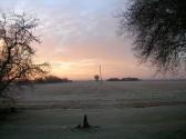 Sunrise seen across the frosty fields off Pymoor Lane, Pymoor.