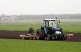 Roger Parson & Tony Rudderham drilling Beet.Laurel Farm, Pymoor,  is in the background 2007.