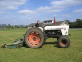 Steve Saberton preparing the Pymoor  cricket outfield for the coming season.