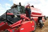 Roger and Dale Parson with their Combine Harvester at Oxlode Farm, Pymoor, 2006 .