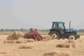 Tony Rudderham baling hay at Oxlode Farm, Pymoor.