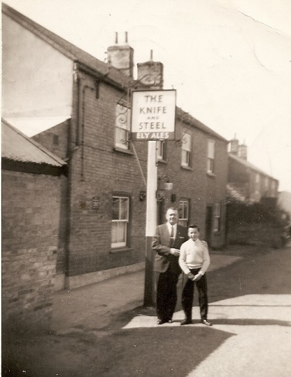 Outside the Knife and Steel, Main Street, Pymoor, circa 1960.