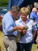 Norman and Pam Golding consult the program at the Pymoor Show, July 2007.