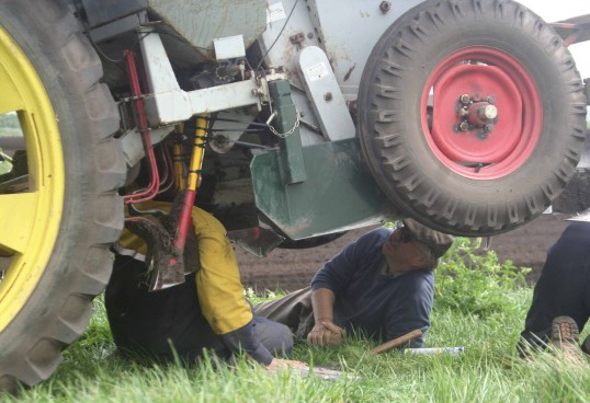 Roger and Dale Parson from Pymoor, getting down to some minor repairs at their farm at Coveney 2007.