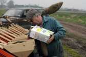 Roger Parson loading up with sugar beet seeds in Pymoor 2007.