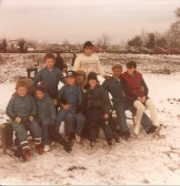 A group of skaters pose for a photograph on the snow covered frozen Washes in Pymoor 1985.