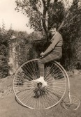 Cynthia Parson on a Penny Farthing Bicycle in Pymoor 1960.